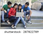 Group Of Friends Using Laptop...