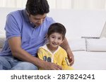 young father assisting his son... | Shutterstock . vector #287824241