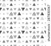 Vector seamless pattern of colored triangles drawn by hand
