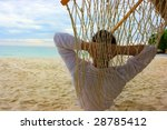 young man relaxing on the sand... | Shutterstock . vector #28785412