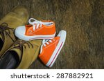daddy's boots and baby's... | Shutterstock . vector #287882921
