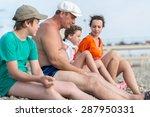 family of four sitting on... | Shutterstock . vector #287950331