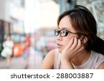 asian girl with glasses looking ... | Shutterstock . vector #288003887