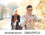businesswoman checking time... | Shutterstock . vector #288109511