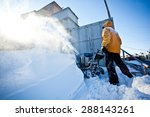 Worker In Yellow Winter Jacket...