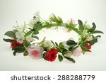 Tiara Of Artificial Roses On A...