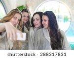 Four Young Women Relaxing In...