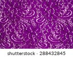 Small photo of lace fabric texture. background. Isolated on white background. the color of Byzantium, fandango, heliotrope, Tyrian purple, raspberry rose, rosewood, maroon