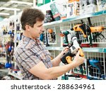 man shopping for perforator in... | Shutterstock . vector #288634961