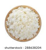 Wood Bowl Full Of Rice On Whit...
