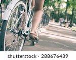 closeup woman riding by blue... | Shutterstock . vector #288676439