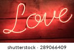 Red Neon Love Sign With Wooden...