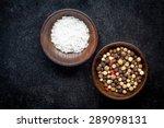 Peppercorns And Sea Salt In A...