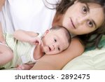 young woman with her baby laid...   Shutterstock . vector #2892475