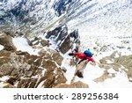 Climber Ascending A Snow...
