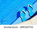 pair of blue flip flops on the... | Shutterstock . vector #289269701