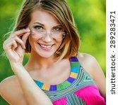 attractive woman pink dress... | Shutterstock . vector #289283471