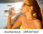 Young Woman Drinking Sparkling...