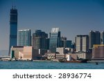 Daytime view of Kowloon's skyline and the construction of Hong Kong's soon to be tallest building the International Commerce Centre. - stock photo