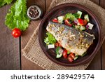 baked seabass with greek salad. ... | Shutterstock . vector #289429574