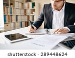 male employee writing business... | Shutterstock . vector #289448624