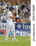Small photo of CHESTER LE STREET, ENGLAND - August 09 2013: Alastair Cook raises his bat to acknowledge the crowd after scoring 50 runs during day one of the Ashes 4th test match at The Emirates Riverside Stadium