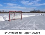 On A Blue Sky Day A Hockey Net...