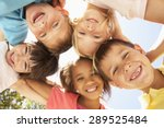 Stock photo group of children looking down into camera 289525484