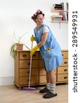 Cleaning Woman Sweeping Under...