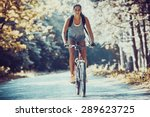 woman riding a mountain bike in ... | Shutterstock . vector #289623725