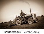 Farmer In Old Fashioned Tracto...