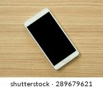 smart phone  on wooden table | Shutterstock . vector #289679621
