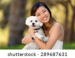 Stock photo little dog with owner spend a day at the park playing and having fun 289687631