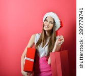 Young Woman In Santa Helper Ha...