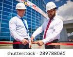 happy architect cutting red... | Shutterstock . vector #289788065
