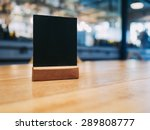 mock up menu frame on table in... | Shutterstock . vector #289808777