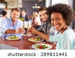 group of friends at lunch in a... | Shutterstock . vector #289811441