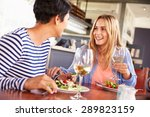 two female friends eating at a... | Shutterstock . vector #289823159