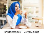 asian muslim woman enjoying a... | Shutterstock . vector #289825505