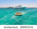 family on tube in water being... | Shutterstock . vector #289853141
