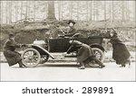 Vintage Photo of People Pushing Old Car - stock photo
