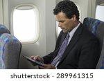 business man on a plane using... | Shutterstock . vector #289961315