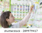 young female pharmacist in a... | Shutterstock . vector #289979417