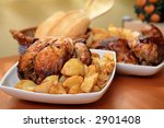 roasted chicken with potato on white bowl ready for eat - stock photo