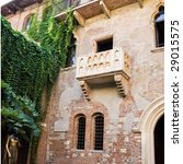 Statue of Juliet and the balcony of her house - stock photo