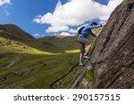 Female Rock Scrambler Climbing...