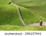 A Hiker Walking Alongside...