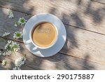 Coffee Cup On Garden Table. To...