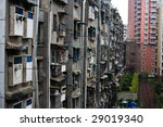 Uniform gray apartment buildings in Chinese city - stock photo