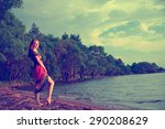 girl in dress walking on the...   Shutterstock . vector #290208629